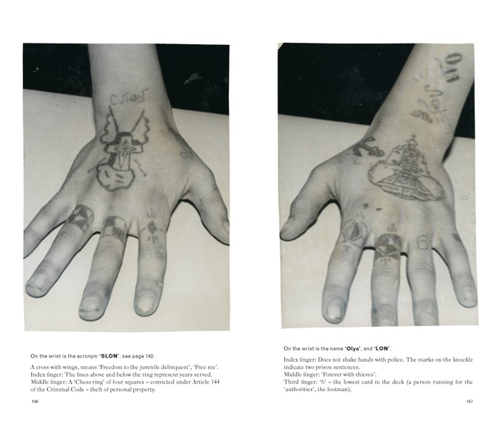 A Russian criminal shows off his hand tattoos