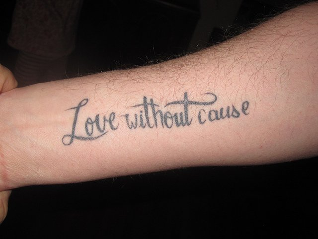 quotes tattooed on forearm