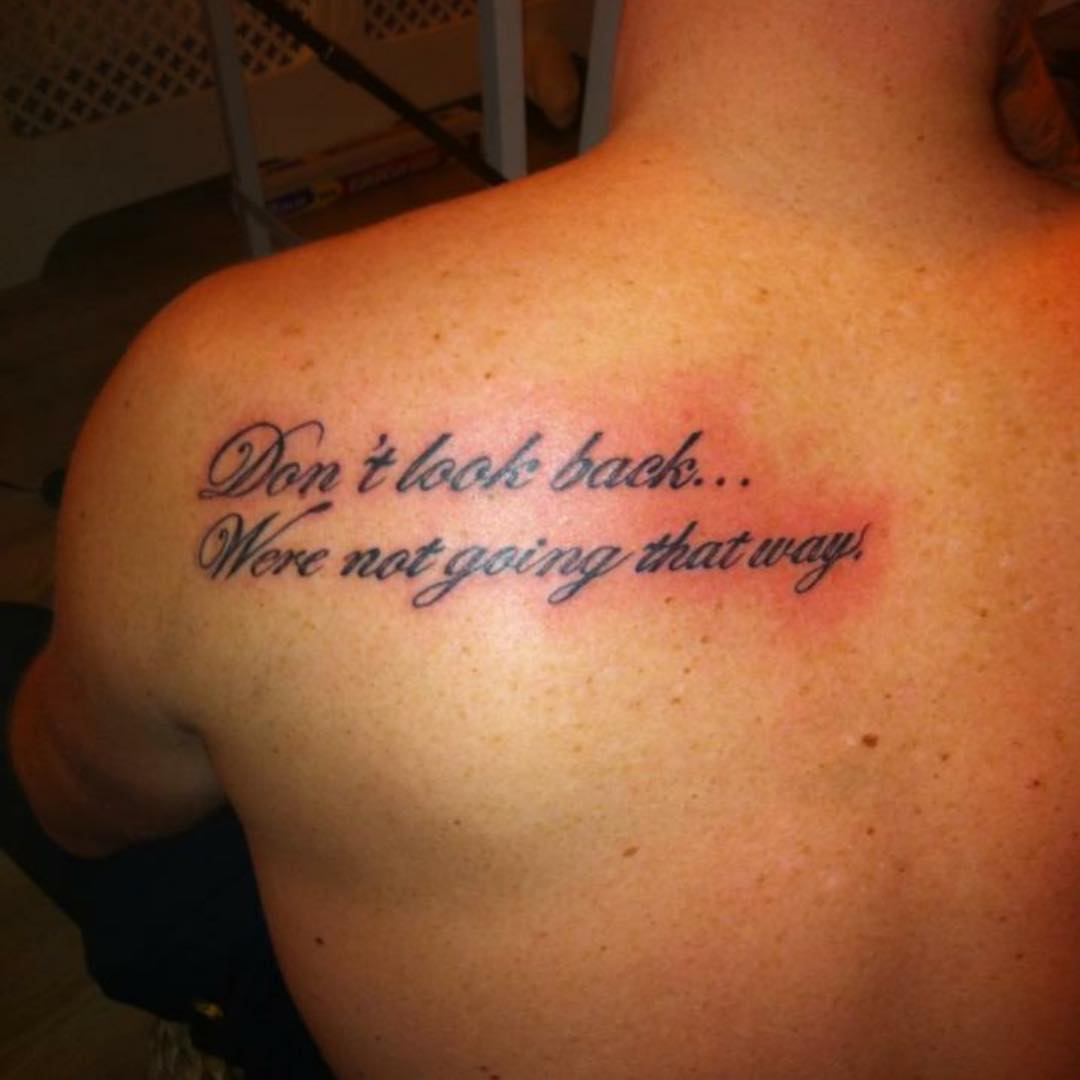 quote on back tattoo