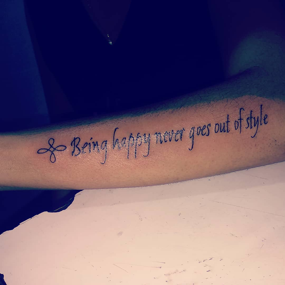 tattoo quote on forearm being happy