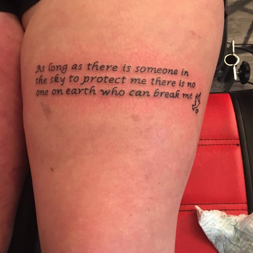 thigh quote tattoo